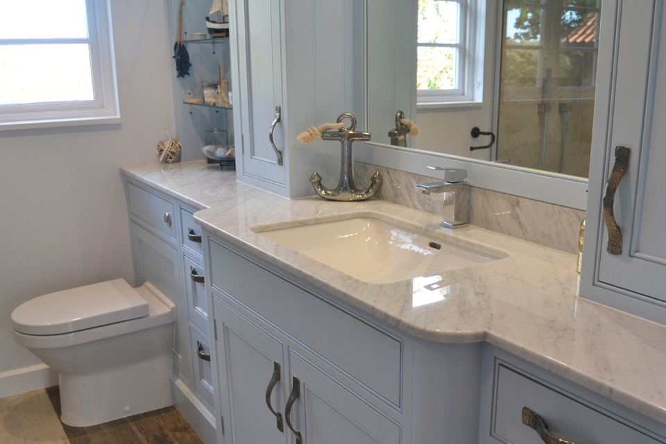 shaker bathroom cabinets in blue with marble surface